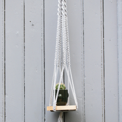 Macramé hang plant with...